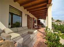 Überdachte Terrasse mit Sofas Finca Mallorca mit Pool PM 3135 für 6 Personen in Caimari